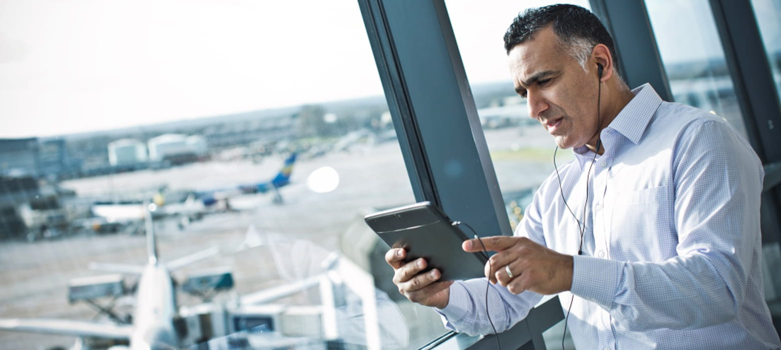 Man using web conferencing software in the airport