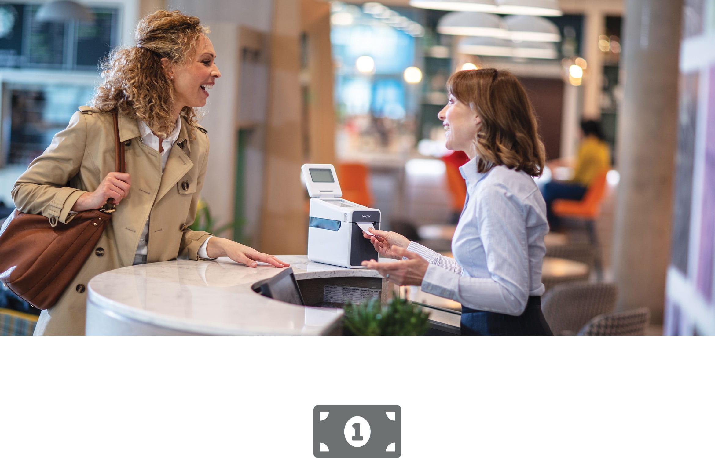 Female sales assistant serving woman at retail checkout