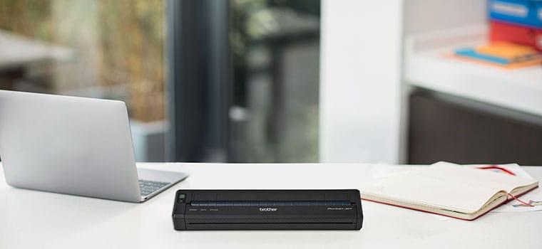 Brother PJ-622 portable document printer on white desk