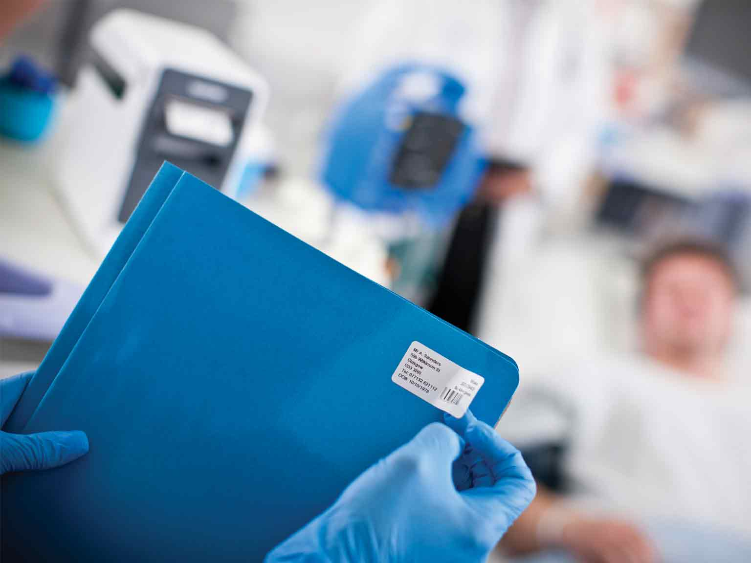 A doctor placing a label on a patient's file