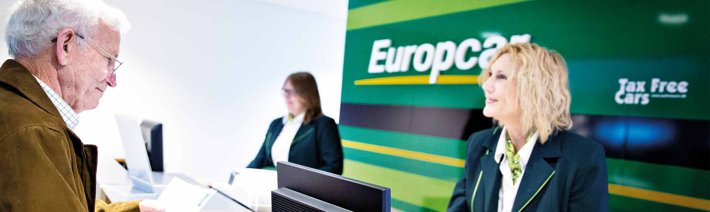 Europcar employee using Brother printer to help customer