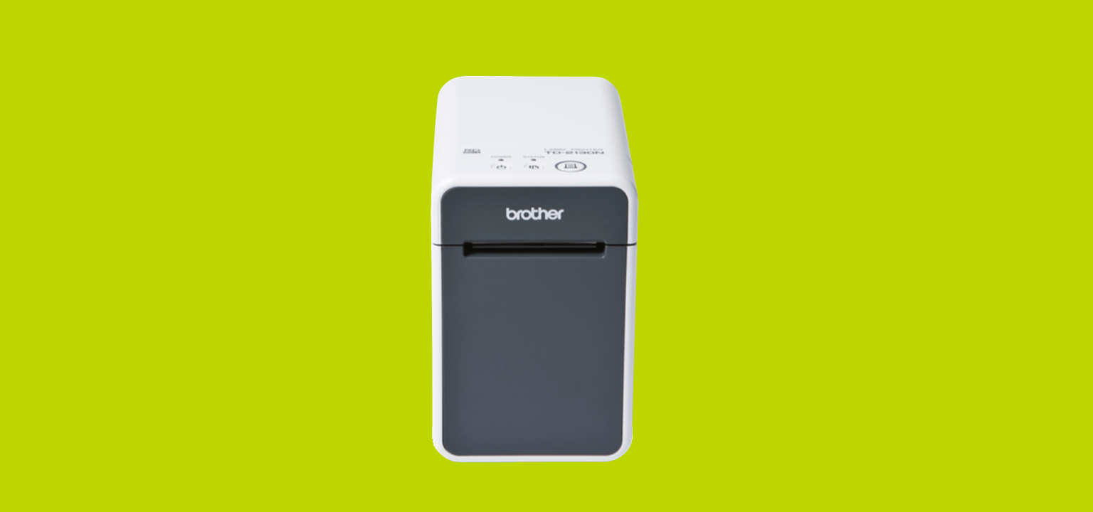 Brother TD label printer on a green background