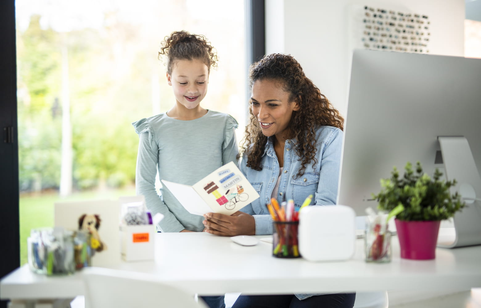 Mother and daughter creating a personalised card using a Brother P-touch label printer
