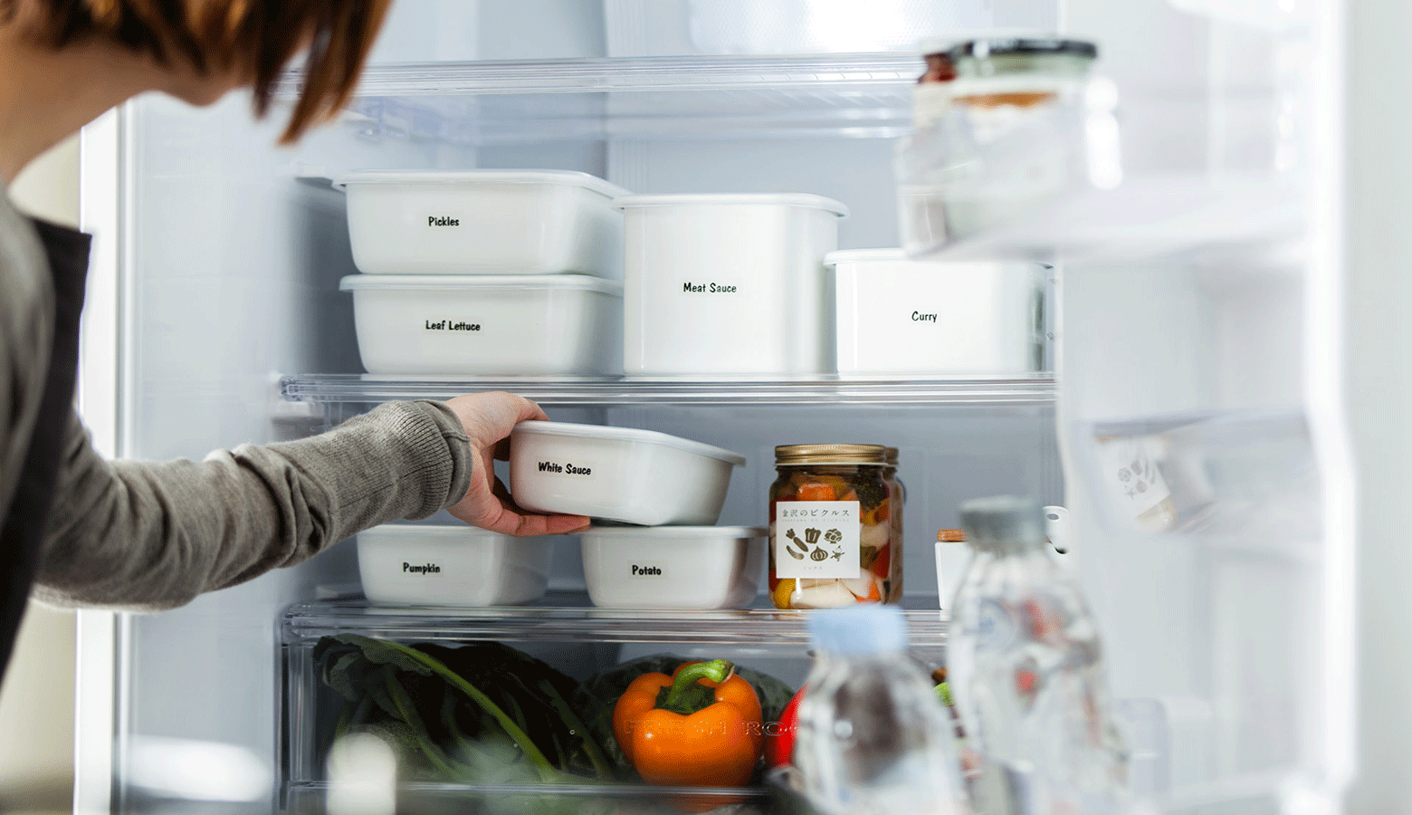 labelled food containers in a fridge