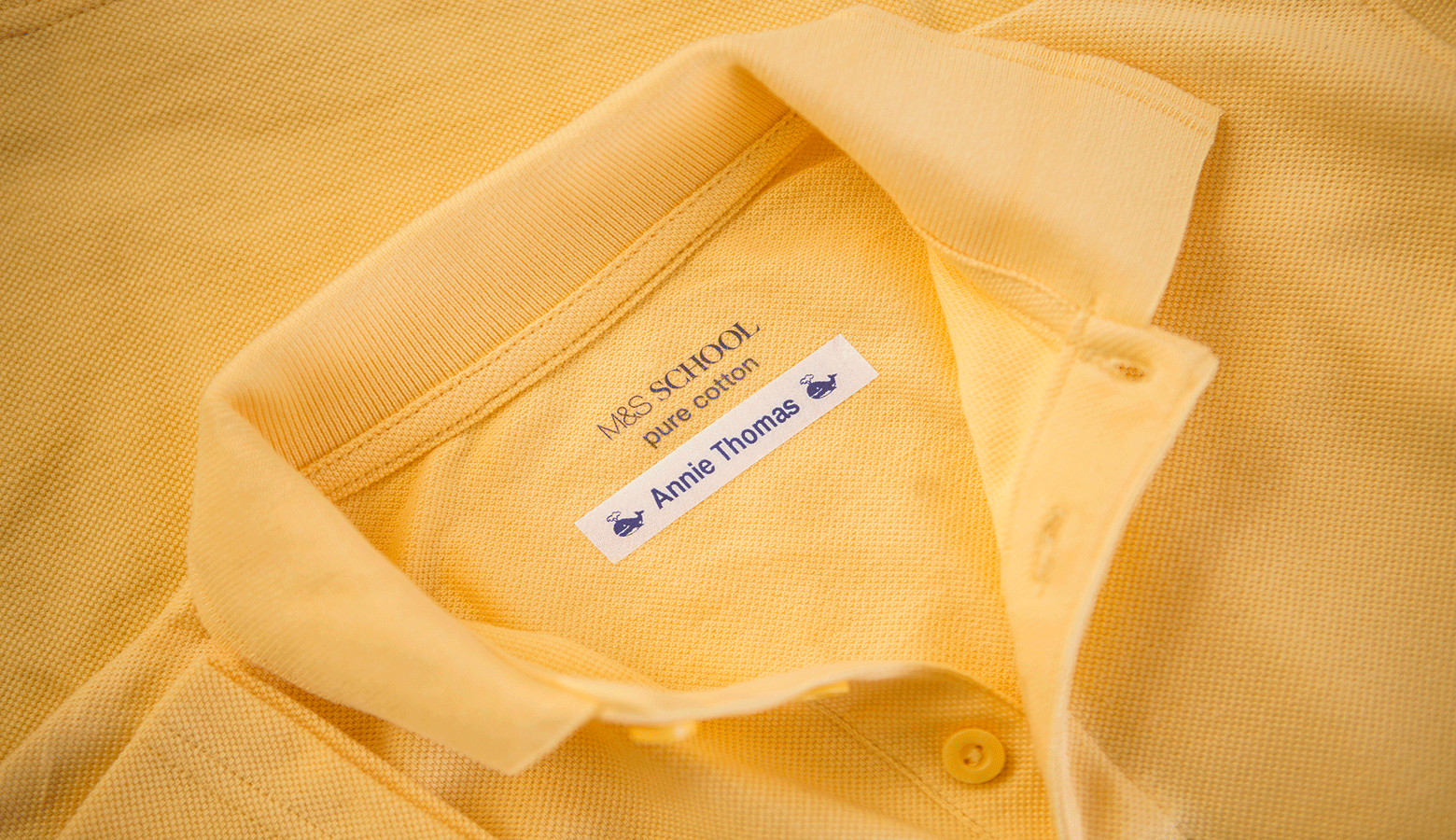 labelled yellow school polo shirt