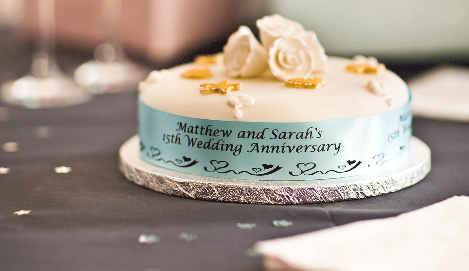 15th wedding anniversary cake with a baby blue ribbon