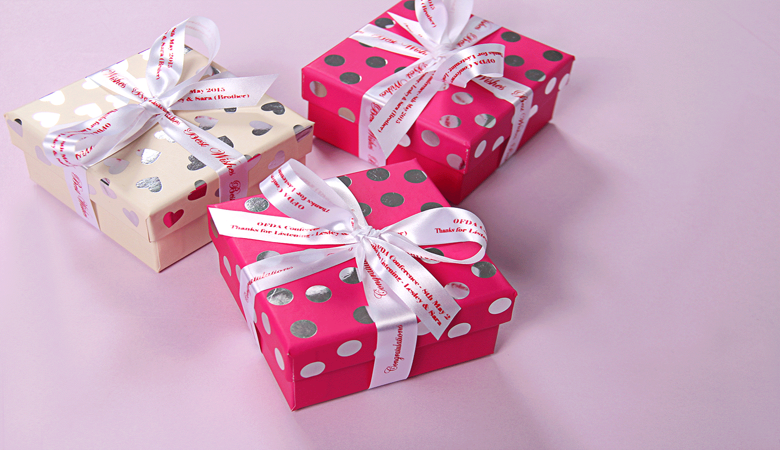 3 gifts in boxes with ribbons