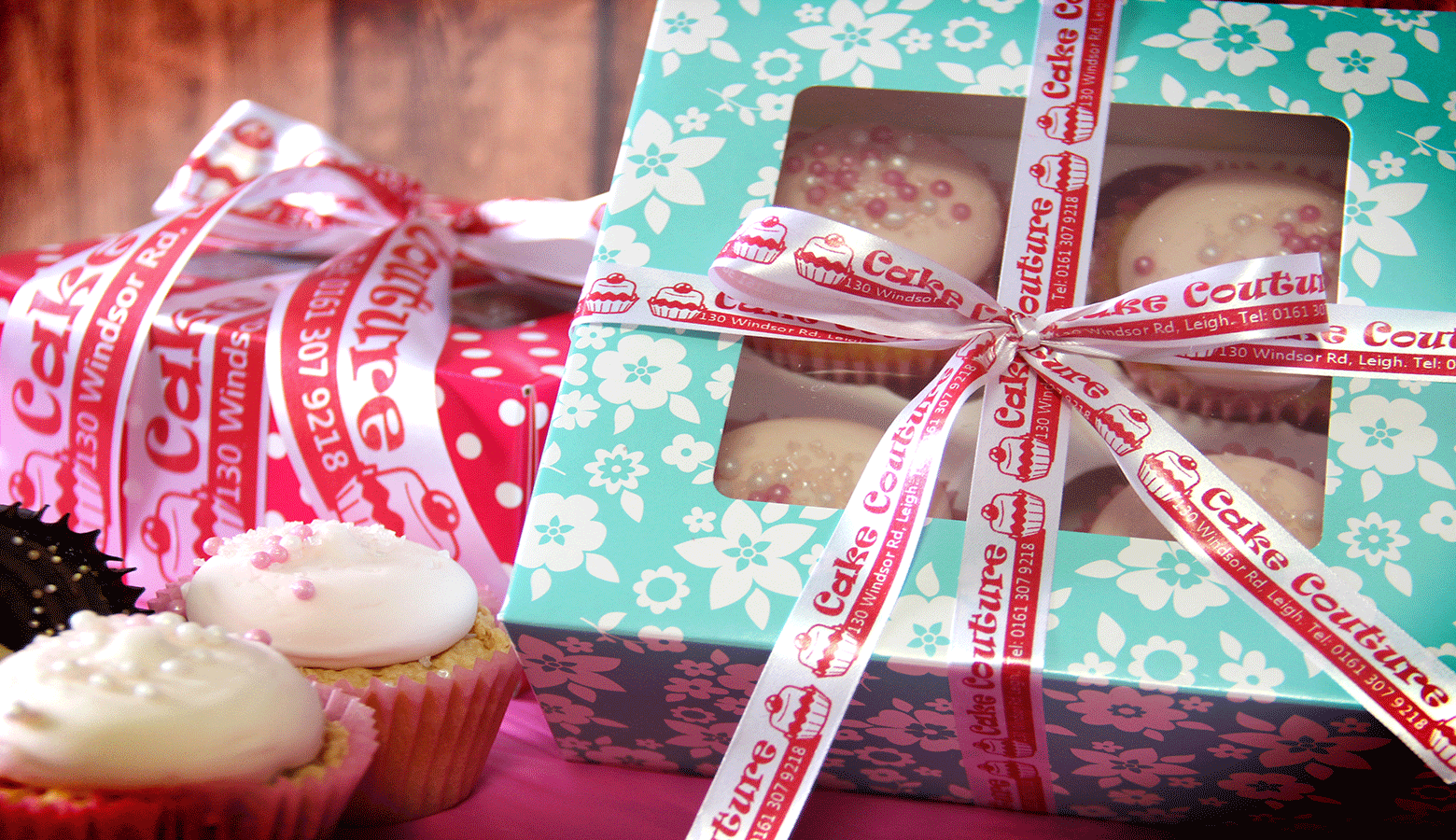 cupcakes in a blue box tied with a ribbon