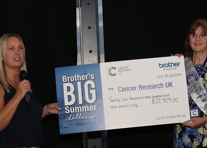 Brother UK present a cheque for over £20,000 to Cancer Research