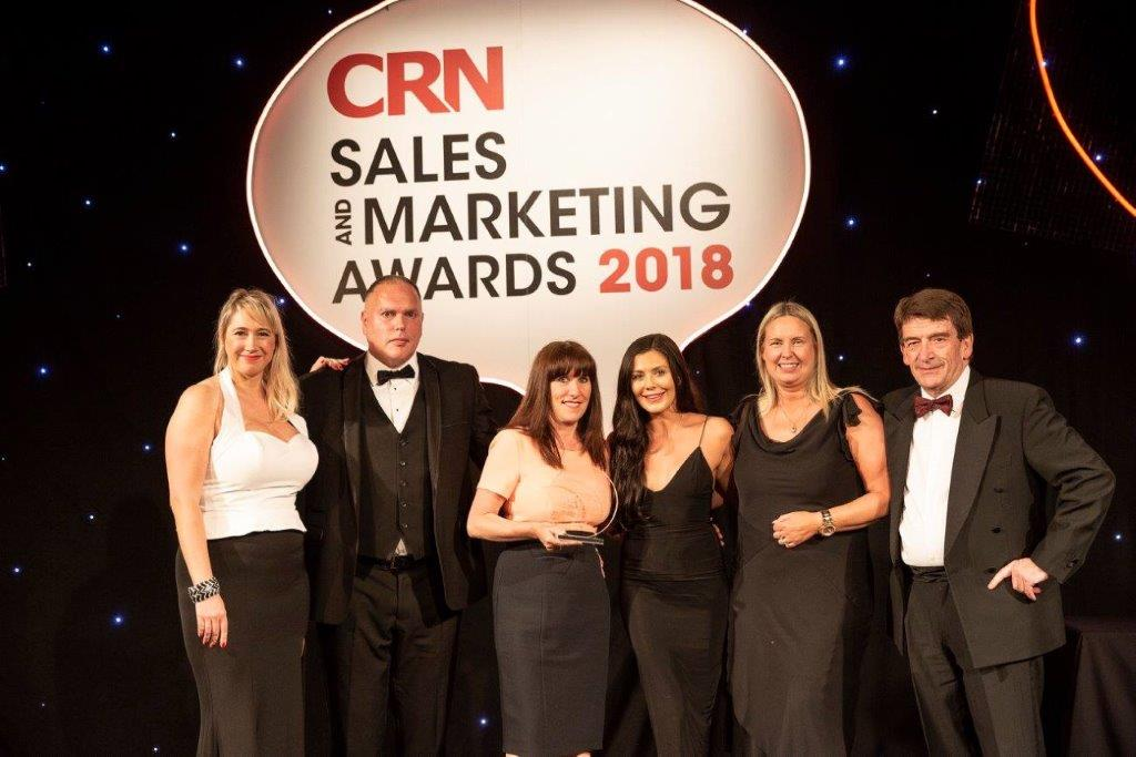 Team members receiving CRN sales and marketing award in 2018