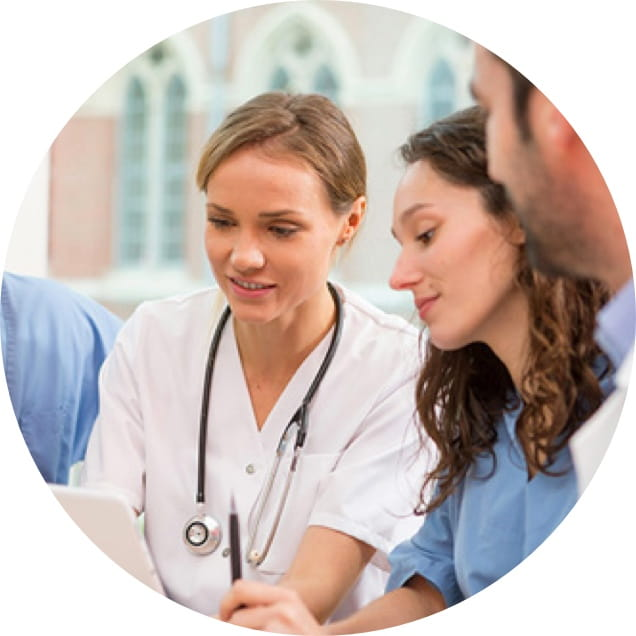 A nurse discusses Omnijoin compatibility with a colleague