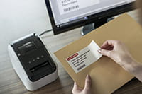 QL-800 label printer with address label containing black and red print