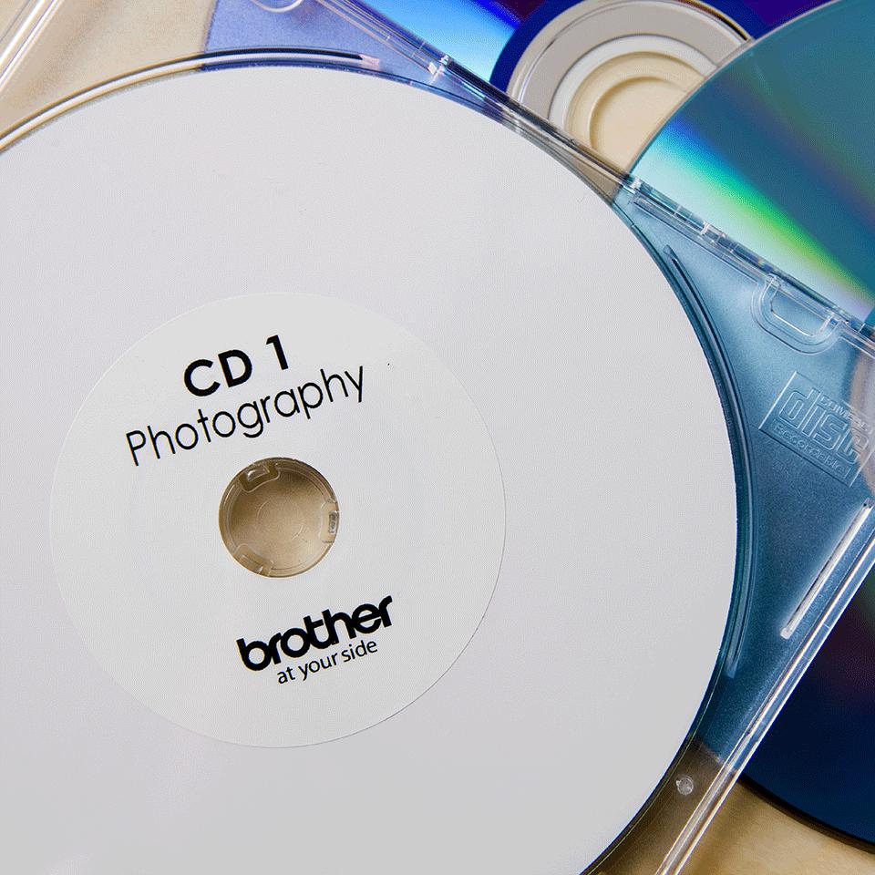 Genuine Brother DK-11207 CD/DVD Film Label Roll – Black on White, 58mm diameter 2